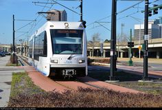 "Hampton Roads Transit operates ""The Tide,"" a light rail line that extends 7.4 miles from the Eastern Virginia Medical Center complex east through downtown Norfolk to Newtown Road at the border of Virginia Beach. The line has eleven stations. On January 20th, 2015, light rail vehicle 401 is seen departing the Harbor Park station, which serves both Amtrak and the stadium where baseball's minor league Norfolk Tides play."