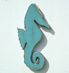 seahorse wood nautical fish wall art by folkybirdsandfish on Etsy, $28.00