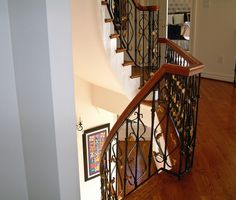 Custom Stair Rails Designed and Executed by Maurice Beane Studios in Richmond, Virginia. #stairrails #wroughtiron #ornamentaliron #rva #mauricebeanedesign