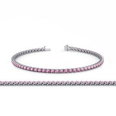 Pink Tourmaline 2.7mm 3-Prong Tennis Bracelet 4.18 ct tw in 14K White Gold. 4.18 ct tw Pink Tourmaline Tennis Bracelet secured using Box with tongue and safety clasp. 55 Round Pink Tourmaline set using 3-Prong Setting. SI1-SI2-Clarity, Pink-Color Pink Tourmaline. Gemstones may have been Treated to Improve their Appearance or Durability & may Require Special Care. The Natural Properties & Composition of Mined Gemstones define the Unique Beauty of each Piece. The Image may show Slight...
