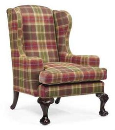 AN IRISH MAHOGANY WING ARMCHAIR