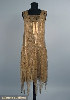 c1925 gold lace and gold lame dress, skirt is overlaid with pennant shaped gold pieces.  augusta-auctions.com