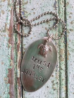 "Hopefully your journey takes you to somewhere beachy! Vintage hand stamped spoon necklace comes with a 24"" ball chain in silver and turtle charm. ~The item pictured is a sample. We create to order, in"