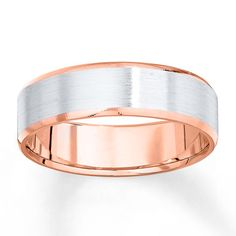 This white gold band outlined in rose gold will handsomely complement your groom on the big day.
