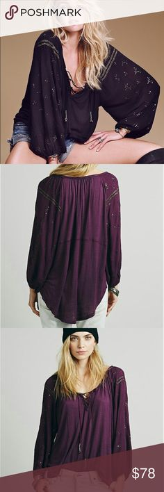 NWT Free People Golden Nugget Peasant Blouse M NWT Free People Golden Nugget Top. Peasant blouse that laces up the front with beautiful embellishments covering from shoulder to hem along sleeves & at ends of laces has silver threading and beads at the end. Size is medium but is meant to have an oversized look to it: (see model pictures). This is in the color aubergine (deep purple). Wonderful top for a variety of seasons! Free People Tops Blouses