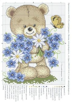 Teddy bear with blue flower