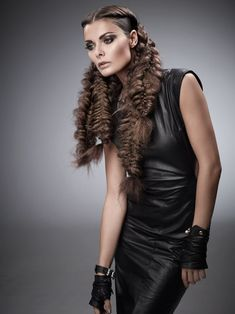 SÃO PAULO CASCADE      Microcrimped texture paired with  pulled-apart braids pulled off the face  creates a futuristic, yet on-trend, fi nish.