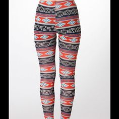 SOFT AZTEC PRINT LEGGINGS These Aztec print Leggings are Navy & a rich Rust shade. They are super soft! They are versatile & can be worn for many different looks. Sizes S, M, L. Polyester/Spandex. No trades. Pants Leggings
