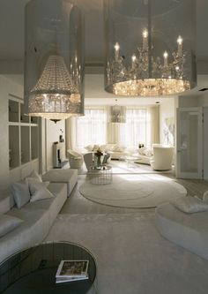 Love the clear cylinder around the fancy chandeliers. Beautiful contrast