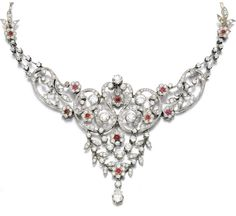 Ruby and diamond necklace, early century: Of foliate swag design, set with circular-cut and pear-shaped diamonds and circular-cut rubies, length approximately Via Sotheby's. Ruby And Diamond Necklace, Ruby Necklace, Ruby Jewelry, Jewelry Necklaces, Fine Jewelry, Weird Jewelry, Diamond Necklaces, Jewellery Box, Diamond Jewelry