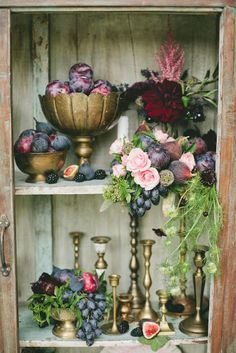 Lovely gold goblets and candlesticks filled with grapes, plums and Black Mission figs for your rustic themed wedding | http://www.beautiful-bridal.blogspot.com