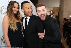 Having a laugh: Justin Timberlake posed with John Legend and his wife Chrissy Teigen while...