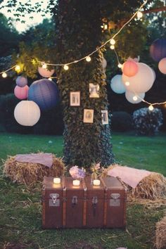 "An ideal boho chic Quinceanera will be held outdoors, think a garden or a green backyard! Hang paper lanterns and white ""ping'pong"" lights around the venue. 