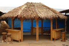 Tiki hut with seating on outside from http://gavaimporting.com/index-1.html