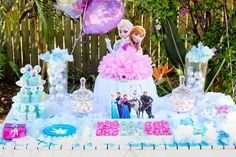 Pretty party table at a  Frozen birthday party! See more party planning ideas at CatchMyParty.com!