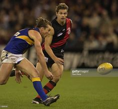 Robert Forster Knight #15 for the Bombers competes with Ben Cousins #9 for the Eagles during the Round 10 AFL match June 1, 2003 between the Essendon Bombers and the West Coast Eagles at the Telstra Dome in Melbourne , Australia.