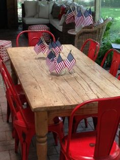 Mini flags in tumblers for a 4th of July party. Really tasteful way to decorate.
