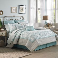 Laura Ashley Halstead Comforter Set -  A large damask print quilted center panel in turquoise aqua is surrounded by a neutral pale tan medallion border. Well thought-out coordinating shams, sheets and accessories complete the look. 100% cotton materials are soft and comfortable. (Queen size cost: 200.)