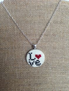 Items similar to Love Embroidered Cross Stitch Pendant Necklace on Etsy Tiny Cross Stitch, Cross Stitch Heart, Beaded Cross Stitch, Cross Stitch Designs, Cross Stitch Embroidery, Embroidery Patterns, Hand Embroidery, Cross Stitch Patterns, Cross Stitch Pictures