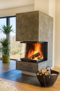 In this living room it becomes really cozy with such a wonderful view. As a small, stylish room divider, the panoramic fireplace from BRUNNER creates . Home Fireplace, Living Room With Fireplace, Fireplace Design, Living Room Decor, Small Living, Family Room, Cottage, Interior Design, Decoration