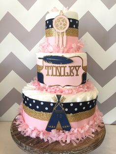 Tribal Diaper Cake in Pink, Navy and Gold, Aztec Baby Shower Centerpiece, Boho by AllDiaperCakes on Etsy https://www.etsy.com/listing/272162324/tribal-diaper-cake-in-pink-navy-and-gold