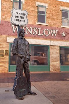 """Standin on the corner in Winslow AZ...  The corner was actually in Flagstaff, at Route 66 and Switzer Canyon where Jackson Browne stood hitch-hiking and conceived the song. He further explained that when it came time to record the song, he decided """"Winslow, Arizona"""" had a better ring to it than """"Flagstaff, Arizona"""". It was at the old Der Wienerschnitzel, which is now Route 66 Dog Haus. And the girl was driving a Toyota, not a flatbed Ford."""