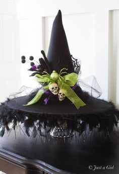 Decorated witch hat | justagirlblog.com Halloween Tricks, Halloween Diy, Happy Halloween, Trick Or Treat, Thanksgiving, Centerpieces, Halloween Trick Or Treat, Table Centerpieces, Thanksgiving Celebration