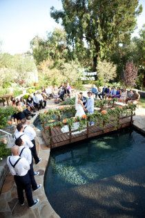 what a great idea for a backyard wedding, just put a bridge over your pool!