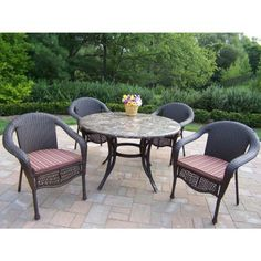 Oakland Living Stone Art Elite Wicker 5Pc Dining Set with Cushions by NewAir Appliances. $1899.80. Includes 1-year manufacturer's warranty. Fade-, chip-, and crack-resistant. Cast aluminum, wicker, and natural stone construction. Hardened powder-coat finish in antique bronze. Includes dining table and 4 cushioned wicker armchairs. This outdoor dining will give your outdoor patio or deck a beautifully natural look; as though its part of the landscaping. Each pi...