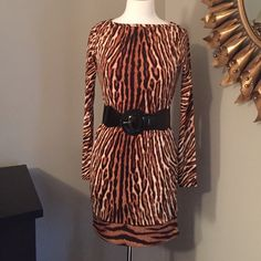 NWT Michael Kors animal print dress NWT! Step into style with this comfy light dress by Michael Kors. You can pair it with a gold belt or wear it loose. Dress it up with heels or down with flat sandals. Very versatile and gorgeous!! Michael Kors Dresses Long Sleeve