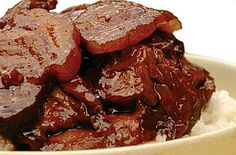 Asado: Cooking style with Spanish and Chinese influences. Pork is simmered in sauces and spices then thinly sliced.