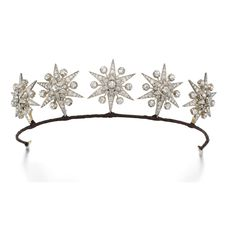 DIAMOND TIARA, 1890S Designed as five star jewels, each set with circular- and rose-cut diamonds, accompanied by two tiara fittings, five hair pins set en tremblant, five pendent fittings, five brooch fittings and one tortoiseshell hair comb, fitted case embossed to the outside K.F.T.