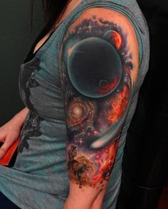 Colored space half sleeve tattoo for women - From solid black to blazing red, the colors are one of the reasons why getting a space tattoo is great. The contrast in colors could make it bold and alive. This one actually looks more fiery.