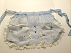 My Babcia's apron that I wore at my own wedding. I plan to make some chiffon aprons modeled after this one <3