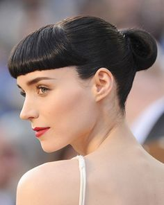"""Rooney Mara  She may have sported a harsh look in """"The Girl with the Dragon Tattoo,"""" but off-screen ladies were swooning over her blunt baby bangs. The key to her look is extending the fringe outward almost to your ears. Mara has since outgrown the haircut she wore last year, but scores of imitators are still devoted to this style."""