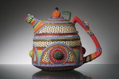'Tribal' Lynne Sausele; 2012 - Beads and Recyled Rubber. Beaded Teapot