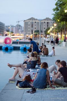 Picnic by the water at Basin de la Villette . Paris