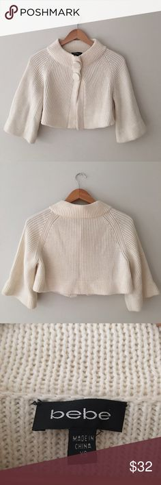 Bebe Knit Shrug Cropped knit capulet/Shrug  in winter white by Bebe. 3/4 sleeves. Two from snap button closure. Size Xtra Small. Great condition! bebe Sweaters Shrugs & Ponchos