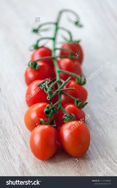 Close-up of cherry tomatoes on a wooden table. Shallow depth of field. Shallow Depth Of Field, Wooden Tables, Cherry Tomatoes, Close Up, Drink, Vegetables, Food, Wood Tables, Beverage