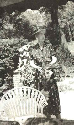 Mme Consuelo Balsan (nee Vanderbilt, the onetime Duchess of Marlborough) in her garden at Old Fields, Oyster Bay, NY (c. 1952).