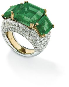 An emerald and diamond ring. Designed as a centrally-set cut-cornered rectangular-cut emerald between similarly cut emerald shoulders with removable pavé-set diamond jacket, ring size N, emeralds weighing approximately 15 carats. Via Phillips. Emerald Jewelry, High Jewelry, Diamond Jewelry, Jewelry Box, Jewelry Rings, Vintage Jewelry, Emerald Diamond, Diamond Rings, Gold Rings