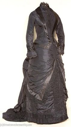 "Victorian Mourning Gown  Front View 1880's original mourning gown. Gown images courtesy of time-travelers antiques on ebay.   ""A most becoming original circa 1880 lady's black silk taffeta 2 piece bustled and trained mourning dress that is a very good example of a woman not sacrificing style at the time of mourning."