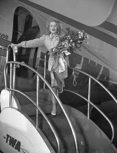 Actress Marlene Dietrich exiting airplane in Los Angeles, California after entertaining troops during World War II (Publication: Los Angeles Daily News - Publication date: August 8, 1946)