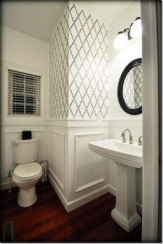 Cute small bathroom.  I like the molding, and the stencil pattern on the walls.