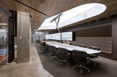 Horizon Media Office / a + i architecture. A retractable 10-monitor screen above the main presentation room table allows the presenter to sit face-to-face with his or her audience while presenting, and gauge reactions immediately