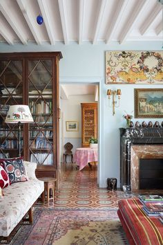 """[i]A painting by Max's grandfather and an eighteenth-century French panel hang over the chimneypiece in the living room.[/i] Like this? Then you'll love [link url=""""http://www.houseandgarden.co.uk/interiors/living-room""""]Living room ideas[/link]"""