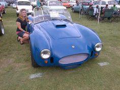Gemma next to an old little car