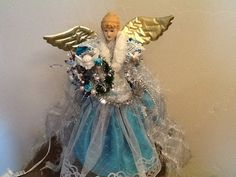 Christmas tree angel....makeover out with the old in with the new...