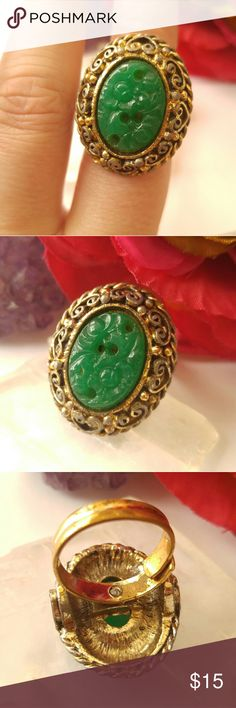 Lovely VTG jade glass ring gold tone This gorgeous vintage ring has a molded flower design center glass stone that looks like jade. It is big and chunky! It is made of gold tone metal. Adjustable size band. The condition is pretty good, there is some wear and age patina to the metal. The band is slightly out of round. From a smoke free home. Offers welcome:)  FawnD8858ring7r5e Vintage Jewelry Rings