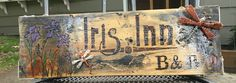 Mailbox sign. Wood burning, acrylic paint, wire, and a clear coat of gloss protectant. Iris Inn BnB